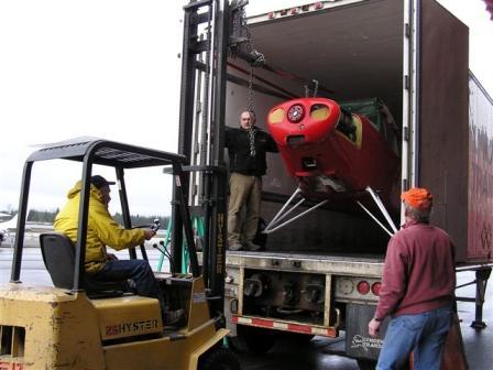 Bishop Plane being unloaded