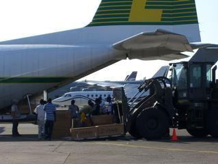 Haiti relief flights - Haiti locals helping to unload Herc