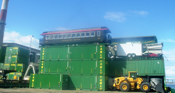 A newly constructed parlor car perched atop Alaska Marine Lines' containers