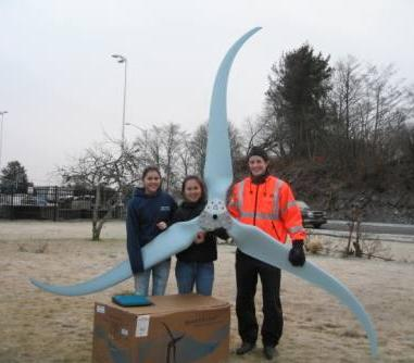 Students and teacher hold turbine blade