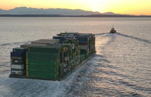 Alaska Marine Lines barge into the sunset