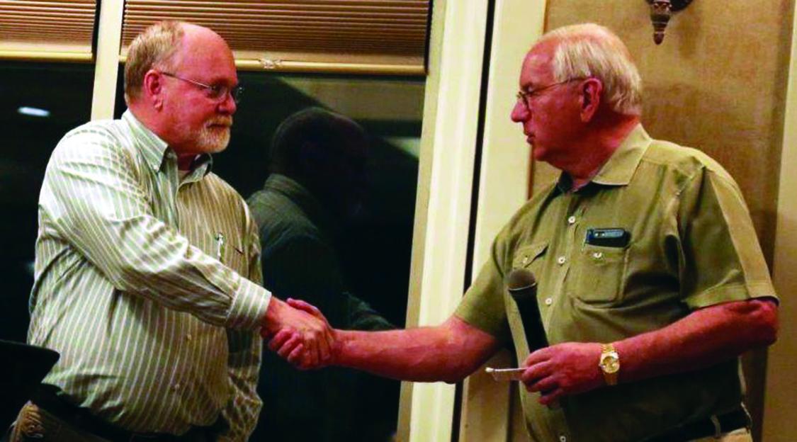 Bob Griggs handshake with Vic Jansen.jpg