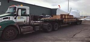 Helicopter fuselage loaded on truck in Anchorage