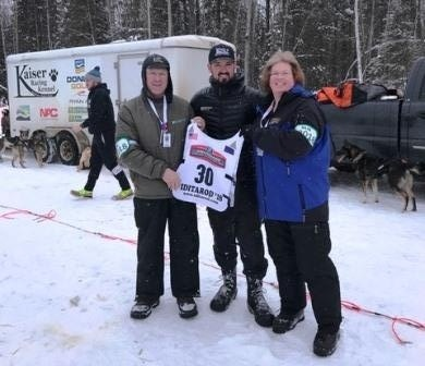 Iditarod - Brian and Jennifer Ambrose with Pete Kaiser at Iditarod start-712682-edited