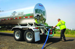 Milky Way Driver Mike Szabo delivers water.