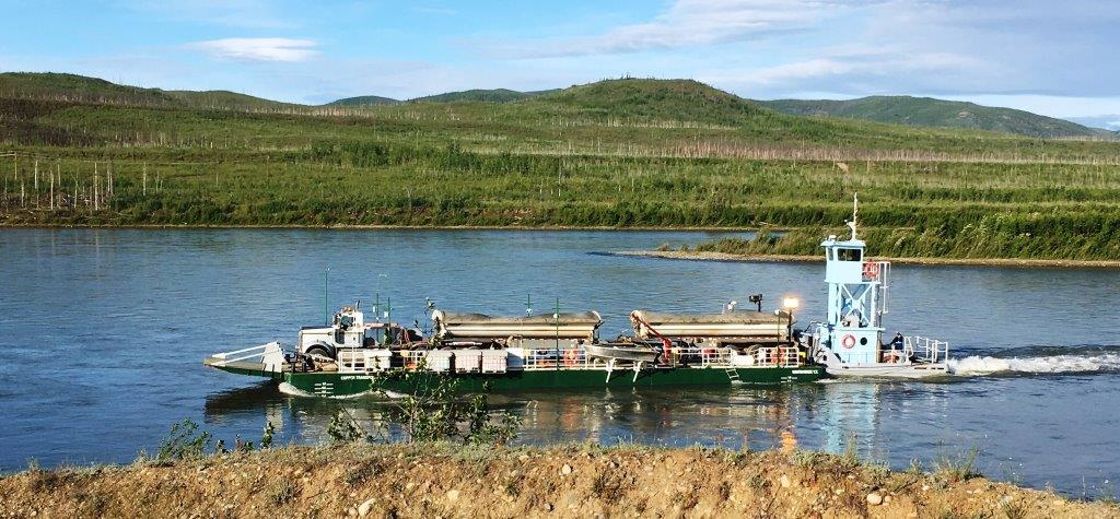 Minto_Mine_-_first_truck_of_the_summer_season_carried_on_barge.jpg