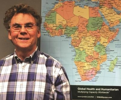 Phil Maxson with map.jpg