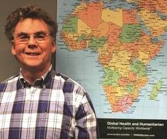 Phil Maxson with map.jpg