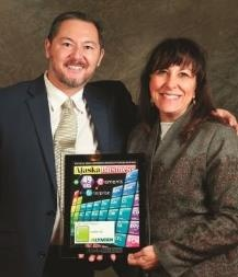 Top 49 luncheon - Jeanine St. John and Charles Bell of Alaska Business Monthly.jpg